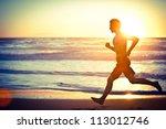 Man Running On The Beach At...