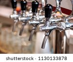 row of beer taps in the bar | Shutterstock . vector #1130133878
