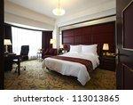 Stock photo hotel bedroom 113013865