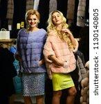 women buy furry coats. girls...   Shutterstock . vector #1130140805