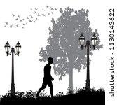 silhouette man walking in the... | Shutterstock .eps vector #1130143622