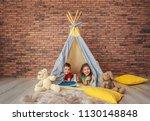 playful little children in... | Shutterstock . vector #1130148848