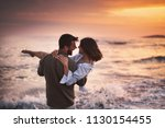 cheerful couple in love at... | Shutterstock . vector #1130154455