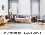 grey curtains behind sofa with...   Shutterstock . vector #1130160935
