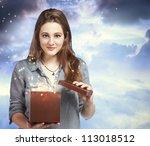 Beautiful Young Woman Opening a Gift Box - stock photo