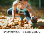 woman stretching in the park ... | Shutterstock . vector #1130193872