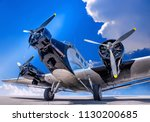 historical airplane on a runway | Shutterstock . vector #1130200685