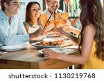 beautiful young woman toasting...   Shutterstock . vector #1130219768