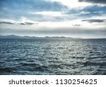 a cloudy day on the wavy sea... | Shutterstock . vector #1130254625