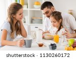 family  eating and people... | Shutterstock . vector #1130260172
