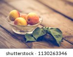 organic apricots on rustic... | Shutterstock . vector #1130263346