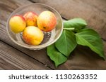 organic apricots on rustic... | Shutterstock . vector #1130263352