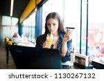 women who is enjoy in cafe | Shutterstock . vector #1130267132
