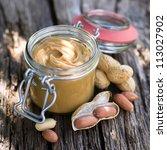 fresh peanut butter on wooden... | Shutterstock . vector #113027902