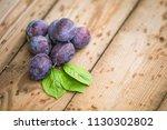 organic plums on rustic... | Shutterstock . vector #1130302802