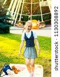 schoolgirl in uniform joyfully... | Shutterstock . vector #1130308892