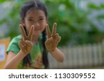 a cute kid makes peace... | Shutterstock . vector #1130309552