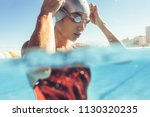 close up of young woman swimmer ... | Shutterstock . vector #1130320235