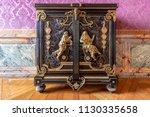 golden and mahogany furniture... | Shutterstock . vector #1130335658
