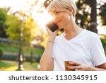 image of satisfied attractive...   Shutterstock . vector #1130345915