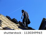 tiling a roof | Shutterstock . vector #1130349965