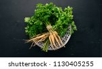 fresh green parsley. root... | Shutterstock . vector #1130405255