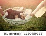 child custody. infant son lie... | Shutterstock . vector #1130409338