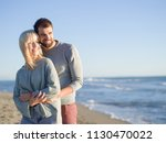 young couple having fun walking ... | Shutterstock . vector #1130470022