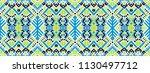 ikat geometric folklore... | Shutterstock .eps vector #1130497712