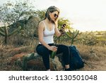 hiker using mobile phone during ...   Shutterstock . vector #1130501048