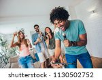 group of friends playing... | Shutterstock . vector #1130502752