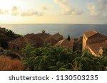 rooftops of monemvasia castle... | Shutterstock . vector #1130503235