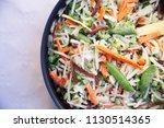 top view of frying pan with...   Shutterstock . vector #1130514365