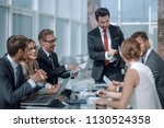 business team discussing new... | Shutterstock . vector #1130524358