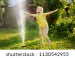 funny little boy playing with... | Shutterstock . vector #1130542955