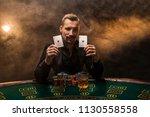 bearded man showing poker cards ... | Shutterstock . vector #1130558558