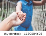 parent and child holding hand... | Shutterstock . vector #1130604608
