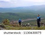 group of tourists guy and two... | Shutterstock . vector #1130630075