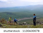 group of tourists guy and two... | Shutterstock . vector #1130630078