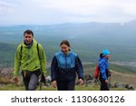 group of tourists guy and two... | Shutterstock . vector #1130630126
