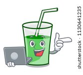 with laptop green smoothie... | Shutterstock .eps vector #1130641235