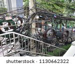 electric pole with  busy  wire  ... | Shutterstock . vector #1130662322