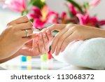 woman in a nail salon receiving ... | Shutterstock . vector #113068372