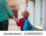 parent take child to school.... | Shutterstock . vector #1130692025