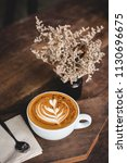 cup of hot latte art coffee on... | Shutterstock . vector #1130696675