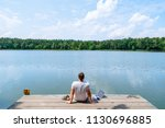 man sitting with laptop and... | Shutterstock . vector #1130696885