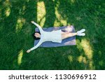 young pretty woman laying on... | Shutterstock . vector #1130696912