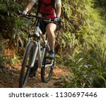 woman cyclist riding mountain... | Shutterstock . vector #1130697446