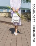 beautiful slim model in a dress ... | Shutterstock . vector #1130709002