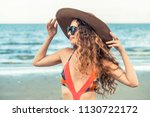 happy young woman wearing... | Shutterstock . vector #1130722172